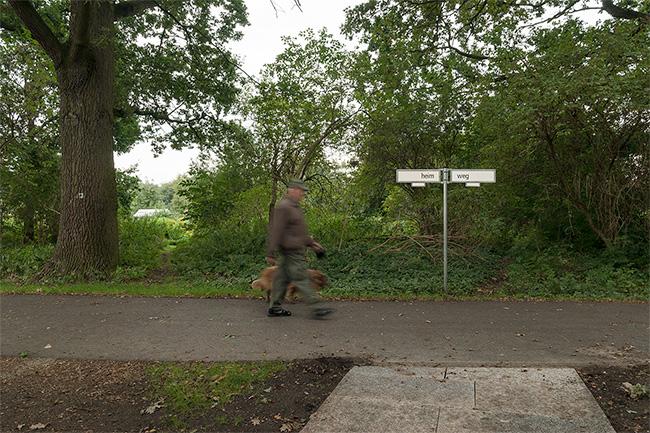 HEIM / WEG, installation, 2015 2 Berlin-based street sign, written character, metal rod, Holder, earth anchor, dimensions: 200 x 110 x 10 cm, 2015